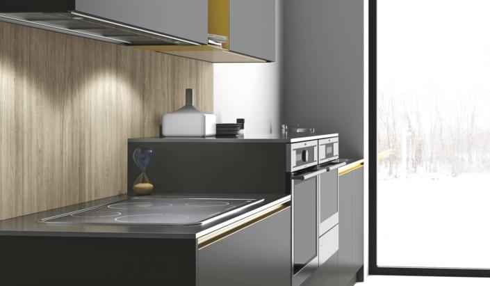 Posición insólita y cómoda para el bloque de hornos donde se juegan con volúmenes en diferentes altura y tamaños, con la placa de inducción.